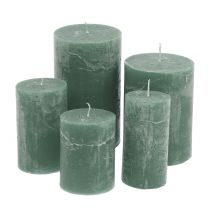 Solid colored candles green different sizes