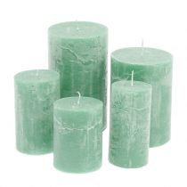 Solid colored candles light green, different sizes
