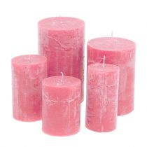 Colored candles pink different sizes