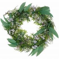 Decorative wreath eucalyptus, fern, flowers. Artificial wreath